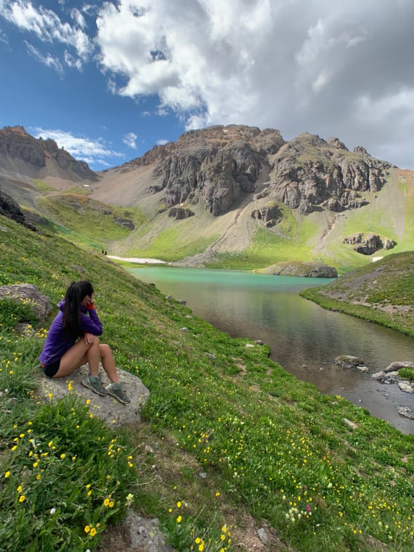girl sitting at edge of island lake colorado
