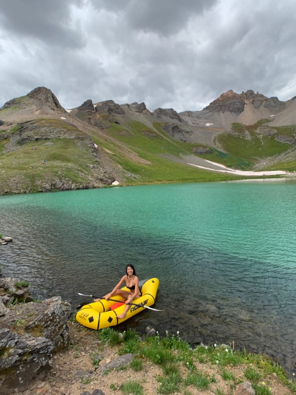 packraft landing in colorado's backcountry lake