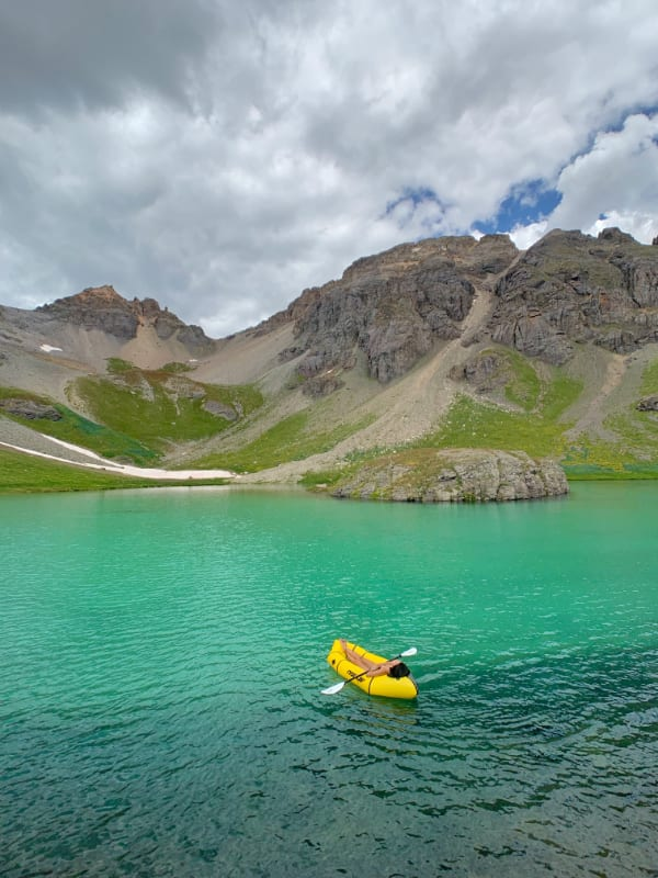 followtiffsjourney floating in kokopelli rogue lite packraft in island lake, san juan mountains colorado