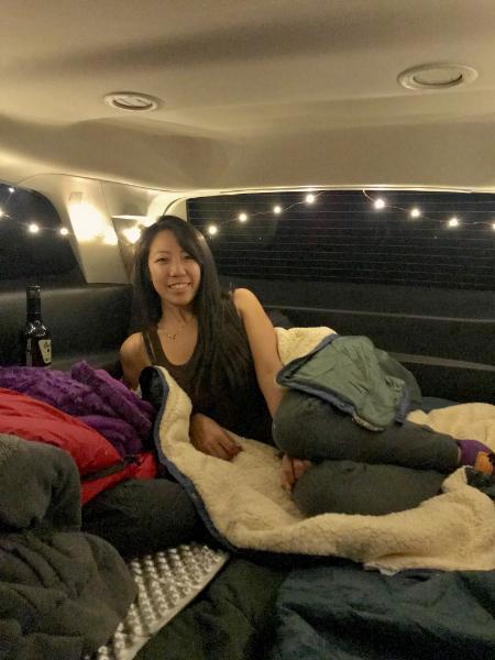 girl in suv car camp