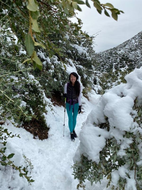 asian girl hiking in snow teal leggings